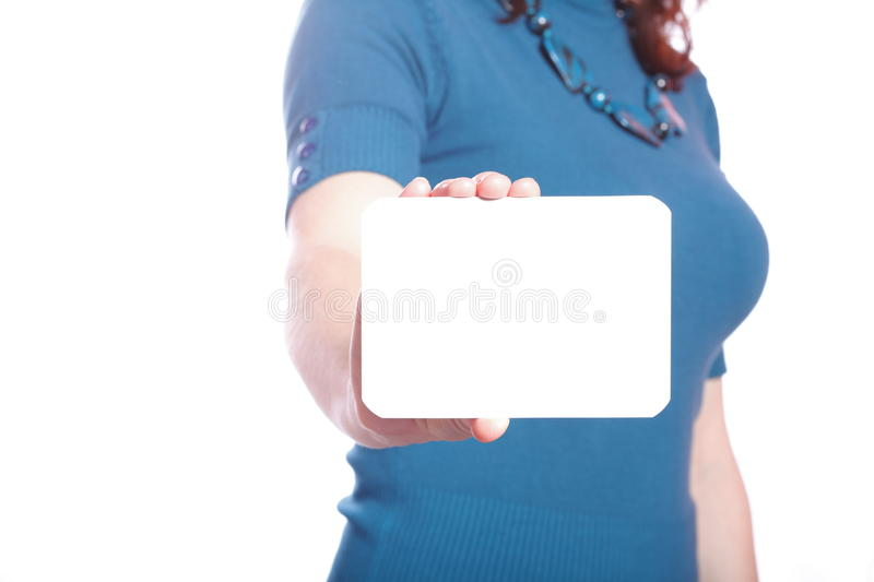 Blank of business card in woman hand. On white royalty free stock photos