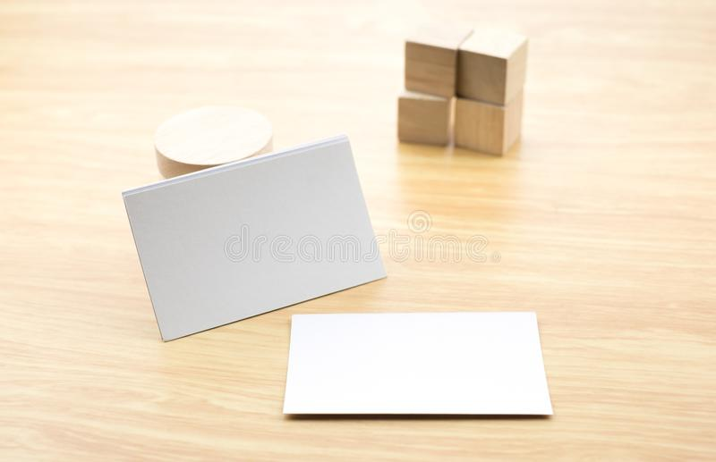 Blank business card on wood table with cube block,mock up template for adding design or text.  stock photos