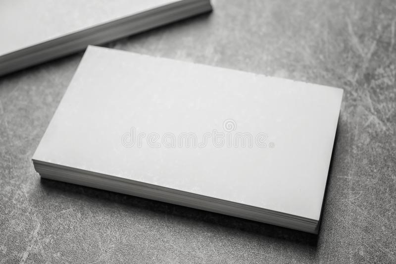 Blank business cards. On grey background stock photography