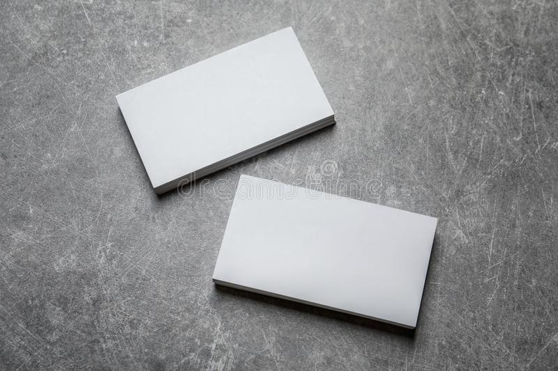 Blank business cards. On grey background royalty free stock photography