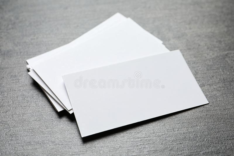 Blank business cards. On grey background royalty free stock images