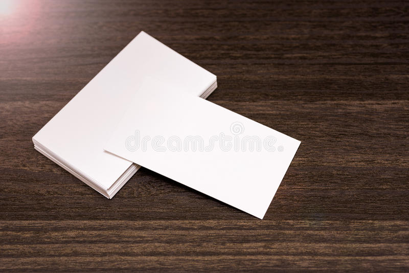 Blank business cards isolated on a dark wooden background stock download blank business cards isolated on a dark wooden background stock photo image of layer reheart Gallery