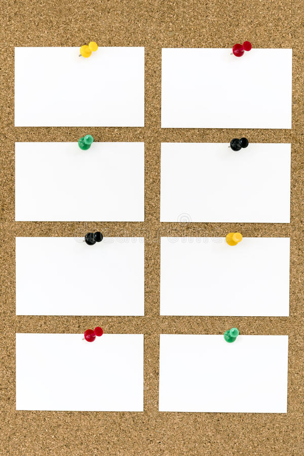 Blank Business Cards with Push Pins on Cork Board royalty free stock photography