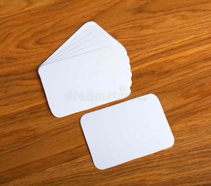 Blank Business Cards With Rounded Corners On A Wooden Background ...