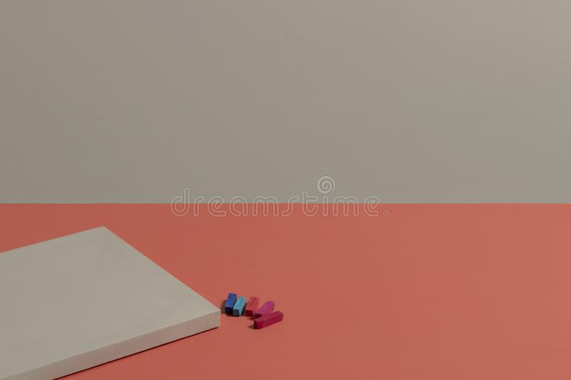 Blank canvas watercolor chalk  coral desk stock photography