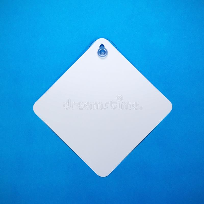Blank car sign on blue paper background. Square label or empty traffic board for your design. Can put text, image, and logo. Blank car sign on blue paper stock photos