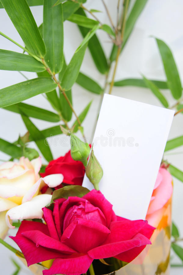 A blank card and flower. A blank card on flower bouquet stock images