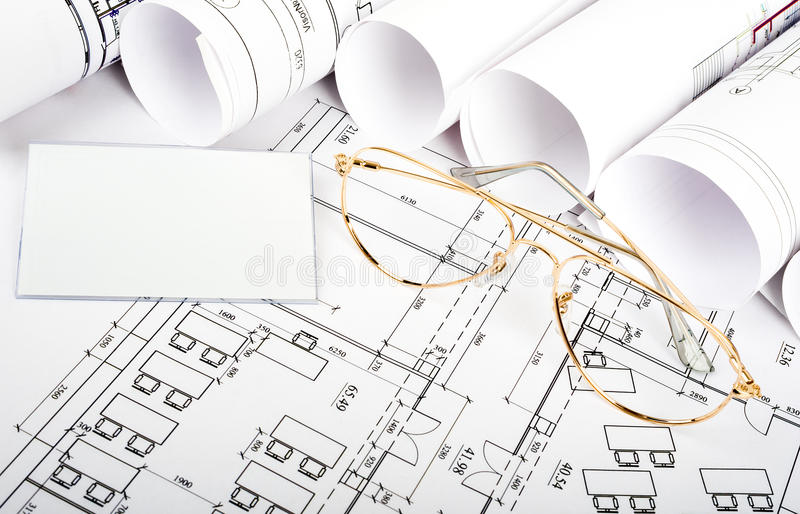 Blank card with glasses on blueprint stock photo