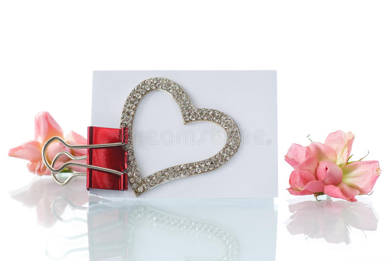 Blank card with heart and roses. On a white background royalty free stock photography