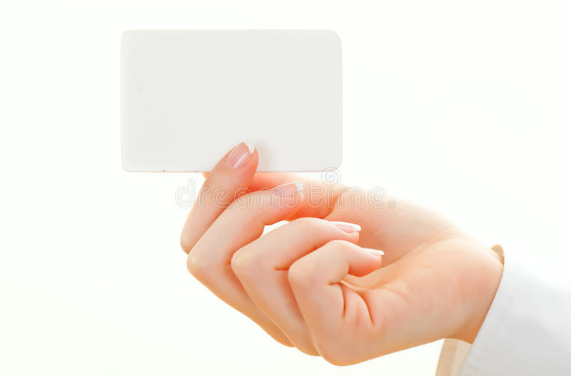 Blank card isolated on white. Female hand with a blank card isolated on white stock photos