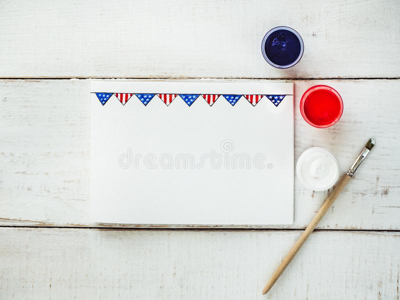 Blank card with a pattern in the form of a US flag. On a white, vintage, wooden table. Top view, close-up royalty free stock images