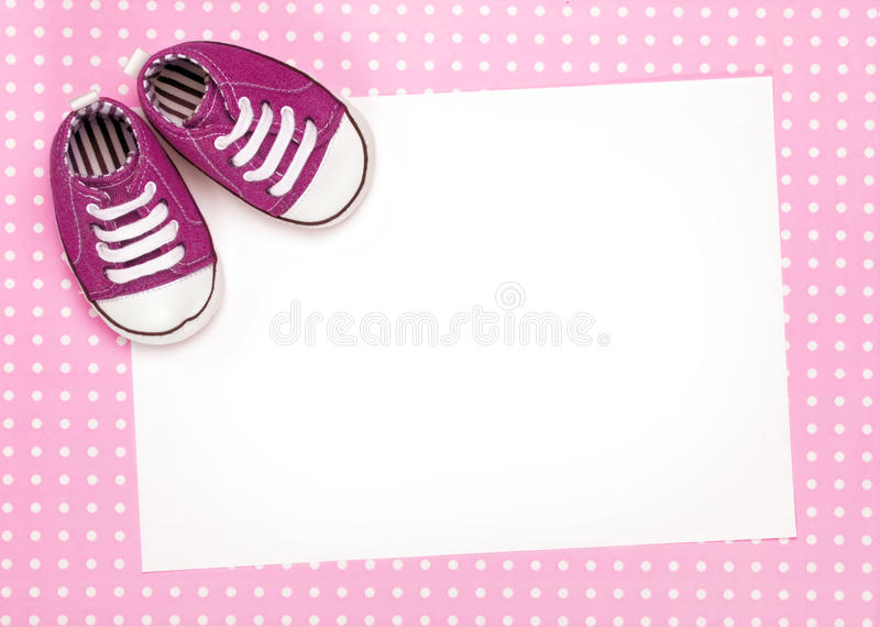 Blank card with pink baby shoes stock photography