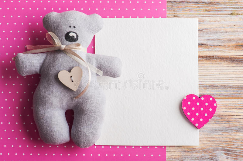 Blank card on pink background with teddy bear stock images