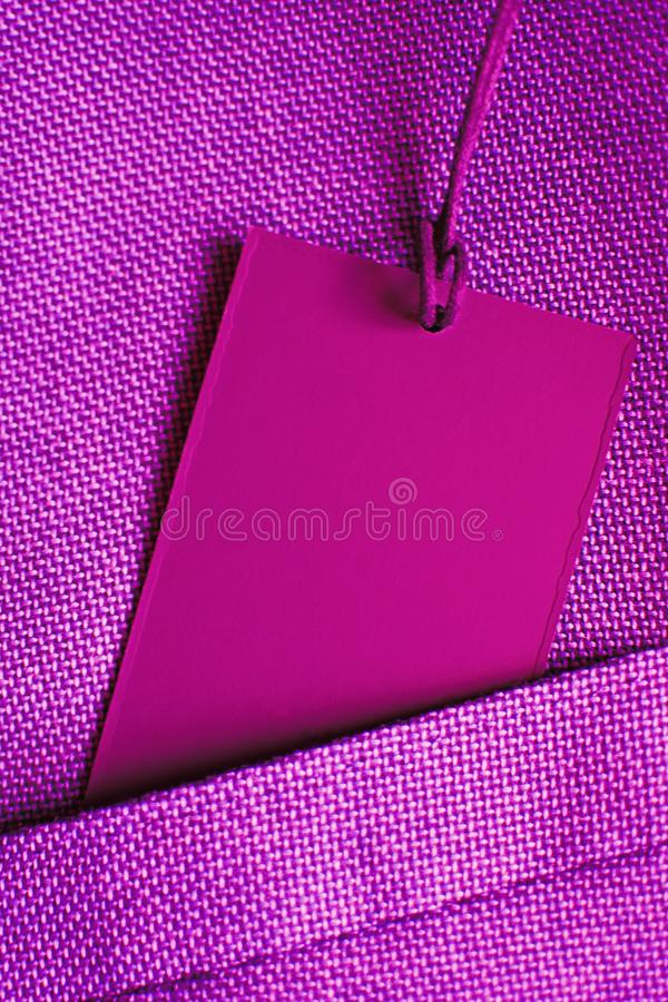 Blank card in pocket of ultra violet suit jacket stock photography
