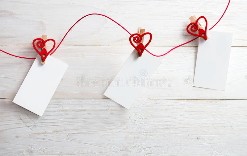 Blank card for text with clothespins hearts.Symbol of love. Blank card for text with clothespins hearts on wooden background.Symbol of love royalty free stock photography
