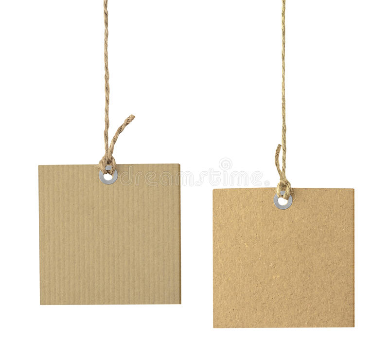 Blank cardboard labels hanging on the rope isolated. Blank cardboard labels hanging on the rope isolated on white royalty free stock images