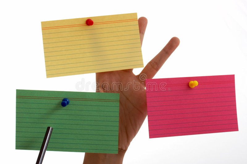 Blank cards. Three blank cards pinned on a hand royalty free stock photos