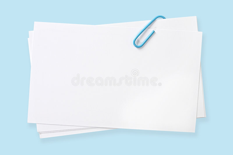 Blank Cards with Blue Paperclip. Blank white cards fastened with blue paperclip. Clipping path included royalty free stock photography