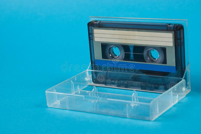 Blank cassette tape box with retro cassette on blue background royalty free stock photo