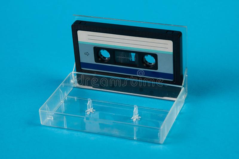 Blank cassette tape box with retro cassette on blue background royalty free stock image