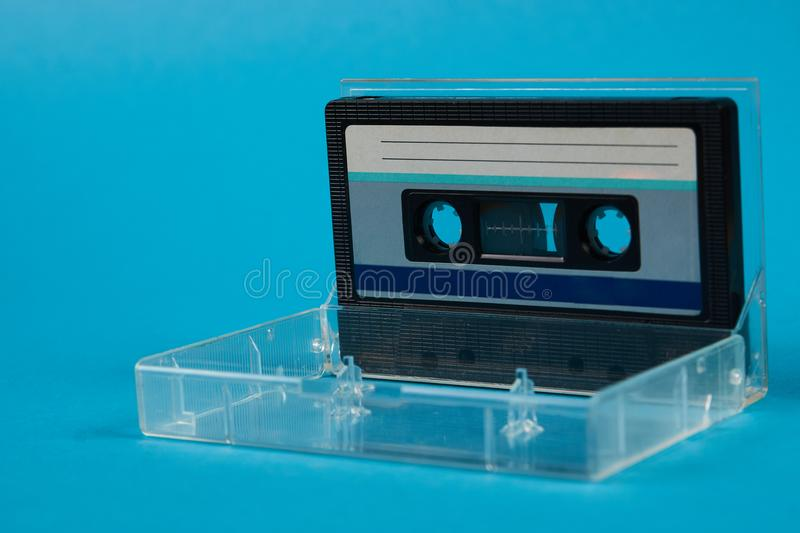 Blank cassette tape box with retro cassette on blue background stock images