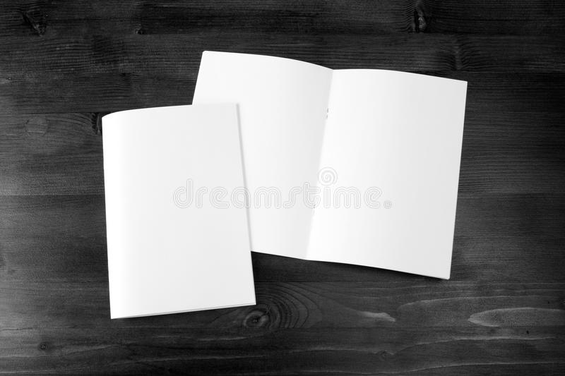 Blank catalog, brochure, book mock up. Empty magazines on wooden background royalty free stock photography