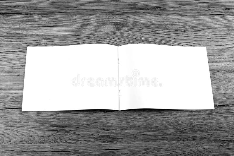 Blank catalog, brochure, magazines, book on wooden background. Top view royalty free stock photos