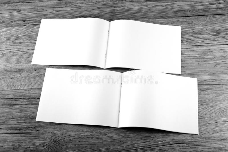 Blank catalog, brochure, magazines, book on wooden background. Top view royalty free stock images
