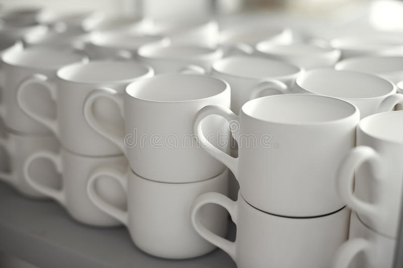 Blank ceramic cups, kiln in a studio, craft work.  royalty free stock photos