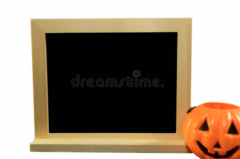 Chalkboard with Halloween pumpkin on isolated white. stock images