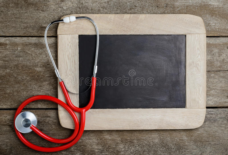 Blank chalkboard, stethoscope, health background concepts. royalty free stock photos