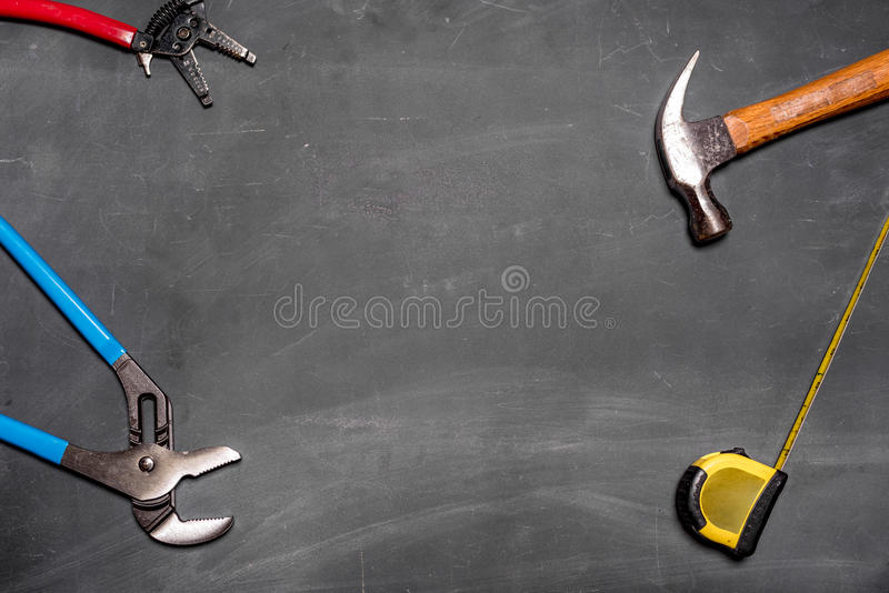 Blank chalkboard with tools stock photo