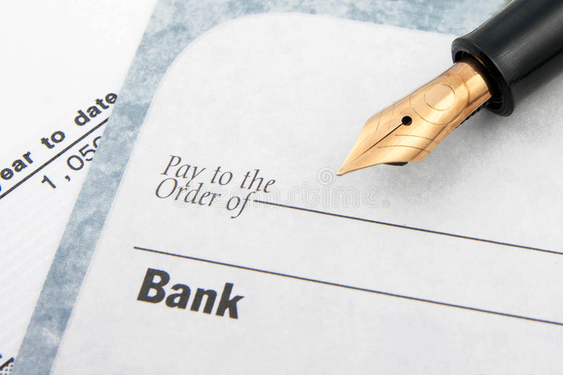 Blank check and fountain pen royalty free stock image