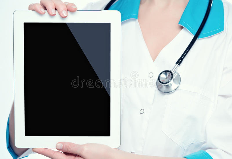 Blank computer tablet in the hands of doctor. Blank empty computer tablet in the hands of doctor royalty free stock photo