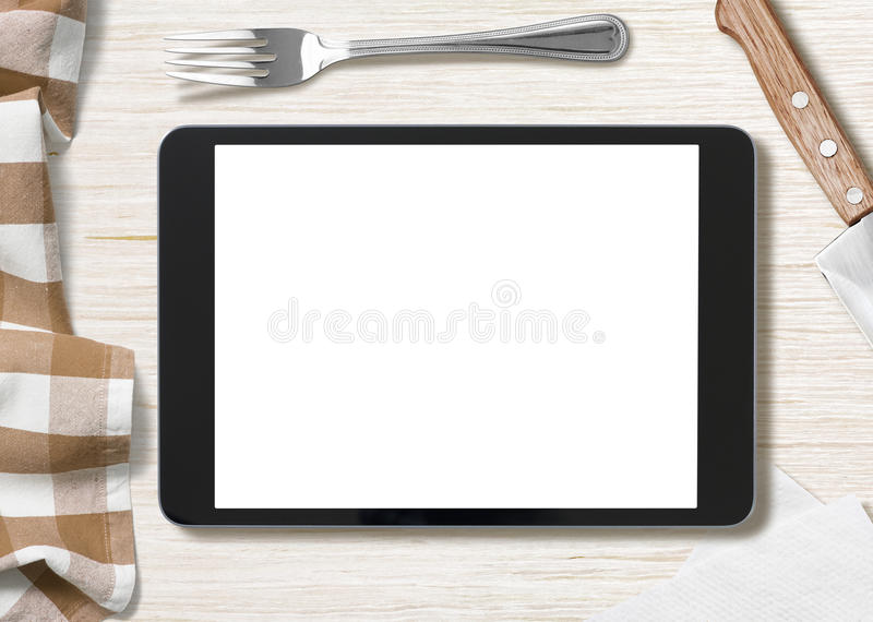 Blank cooking recipe notes on black tablet pc. Cooking recipe notes on tablet pc like ipad lying on table royalty free stock image