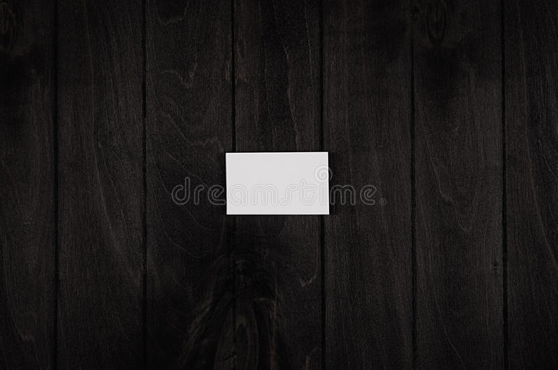 Blank corporate identity business card on black noir wood background, top view, template. Blank corporate identity business card on black noir wood background royalty free stock image