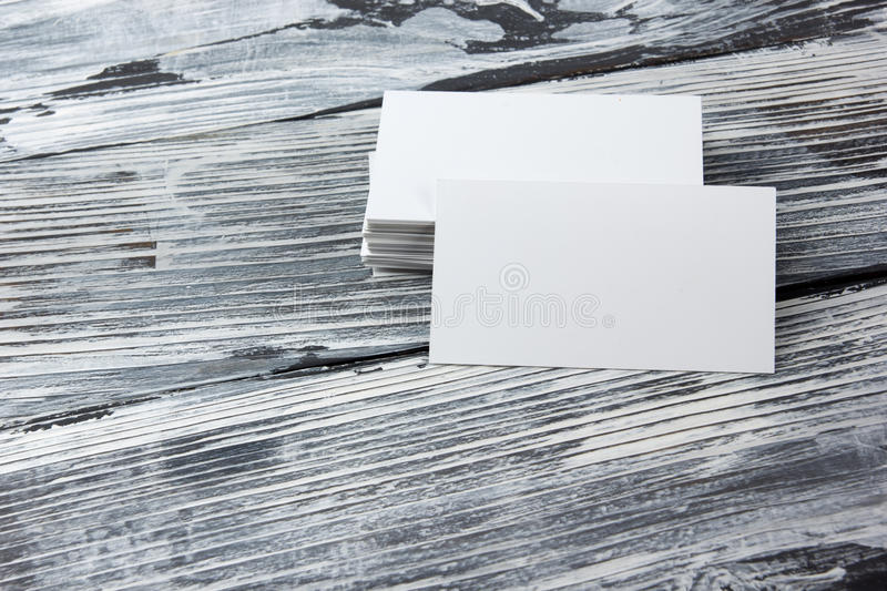 Blank corporate identity template package business cards on wood table. royalty free stock photos