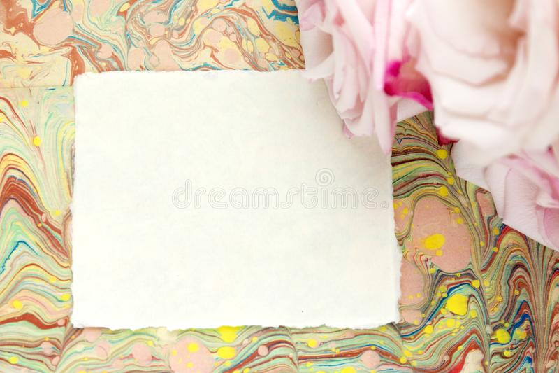 Blank craft background. Sheet of rough paper with roses. Mock up. stock photos