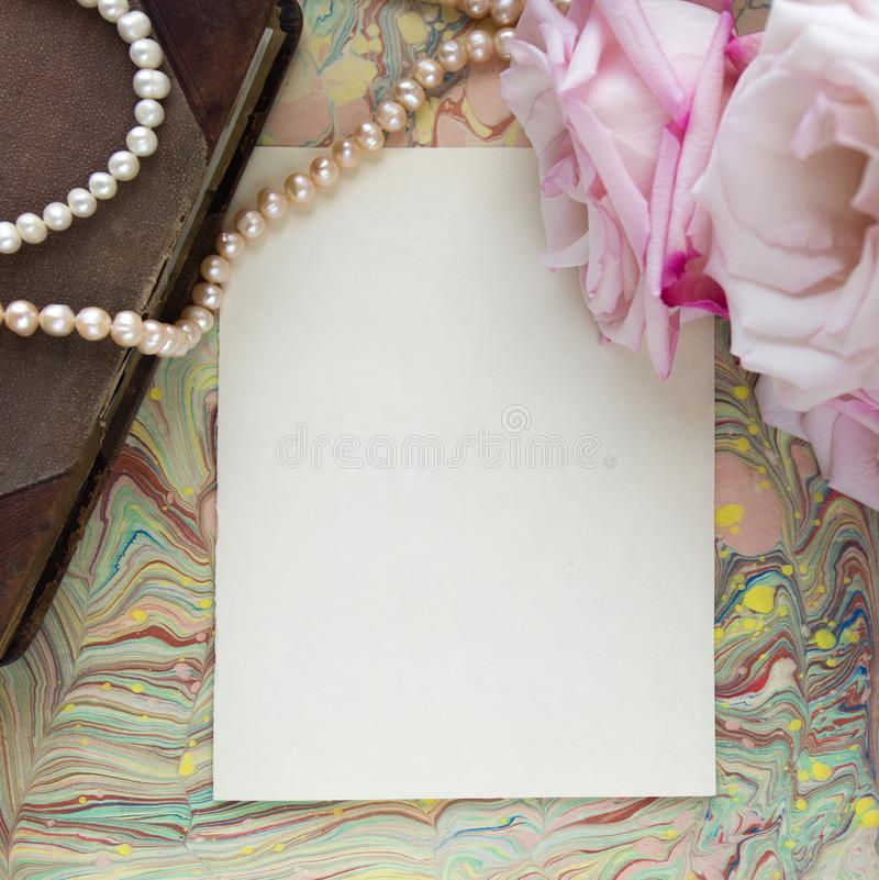 Blank craft background. Sheet of rough paper with roses and pearls. Mock up. stock photo