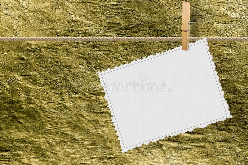 Blank decorated cardboard hanging on a lanyard with a clothesline against a golden plaster wall - concept image with copy space.  stock image
