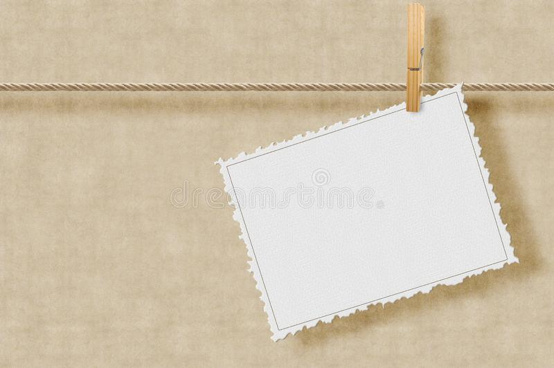 Blank decorated cardboard hanging on a lanyard with a clothesline against a plaster wall - concept image with copy space.  royalty free stock photo
