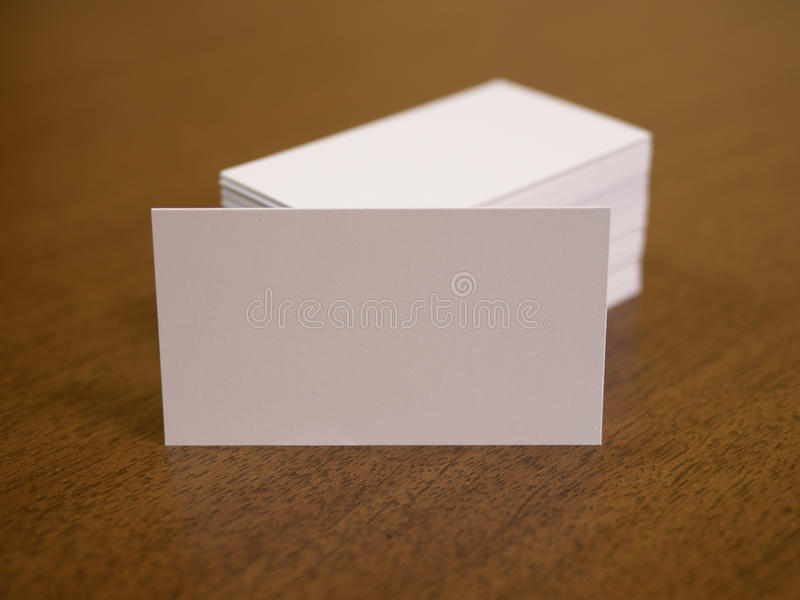 Blank defocus business cards on a wooden. Identity design mockup for corporate presentation. Blank business cards on a wooden background stock photography
