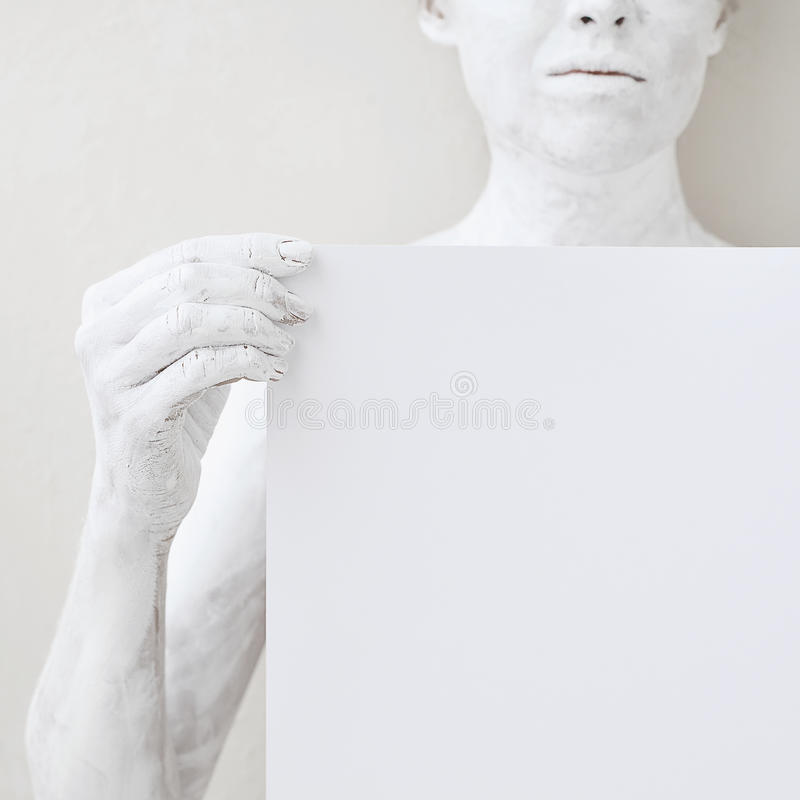 Blank design poster template. Woman covered with white paint holding a paper. Focus on hands royalty free stock images