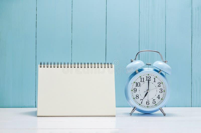 Blank desk calender with vintage Alarm clock stock image