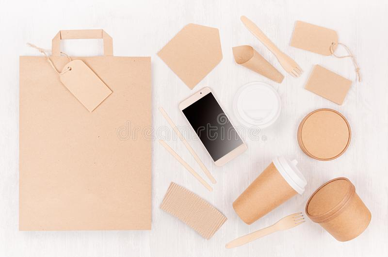 Blank different cardboard packaging for fast food - bag, coffee cup, screen phone, cutlery, sugar, spice, container and box. Blank different cardboard packaging royalty free stock photography