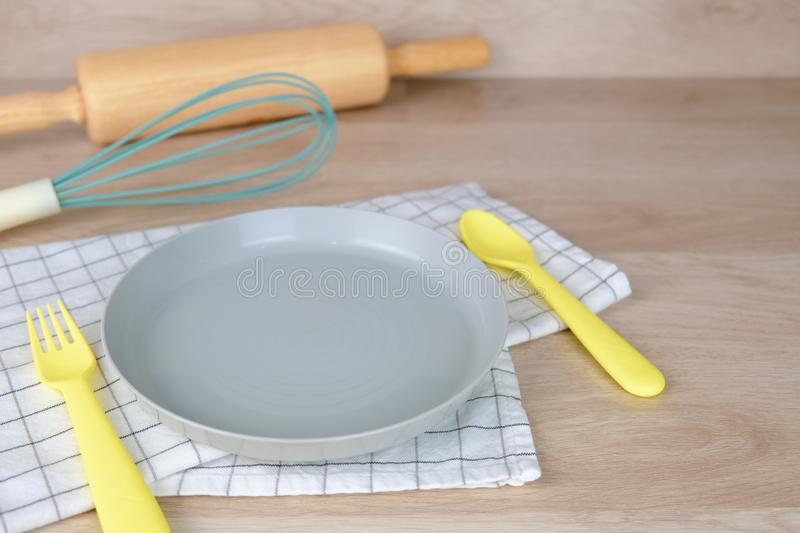 Blank dish or plate pastel color Bakery Party Breakfast at home. Cooking food with Rolling Pin and hand mixing on Wooden stock image