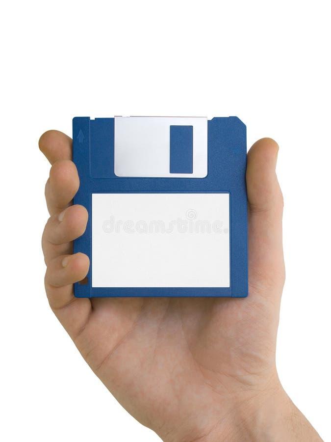 blank diskettfloppyhand royaltyfri fotografi