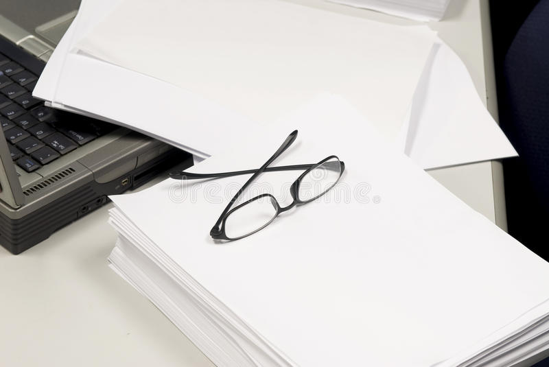Blank document and reading glasses royalty free stock photos