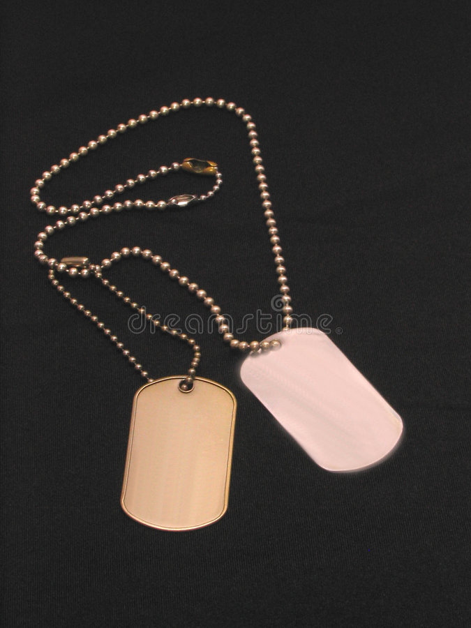 Blank Dog Tags over black royalty free stock image