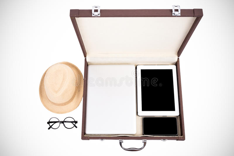 Blank electric devices in briefcase. (filtered process royalty free stock photography